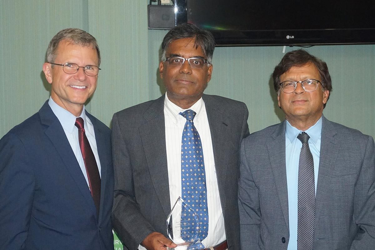 Murali Jagannathan received the Dilip K. Shome Conference Best Paper Award from Pamplin dean Robert Sumichrast and finance department head Vijay Singal. (Photo courtesy of George Morgan and Raman Kumar)