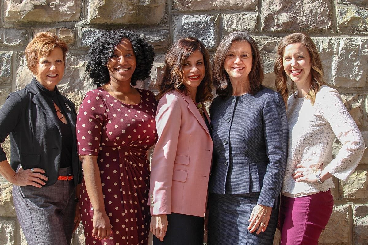 The Women In Business organizing team pose for a photo on campus. From left: Bonnie Gilbert, Janice Branch Hall, Donna Wertalik, Kay Hunnings, Amy Transue. (Photo credit: Daniel Mun)
