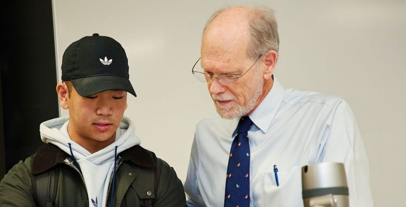 Finance senior Andrew Yang consults with his professor, George Morgan, after class. (Photo credit: Julie Benedetto)
