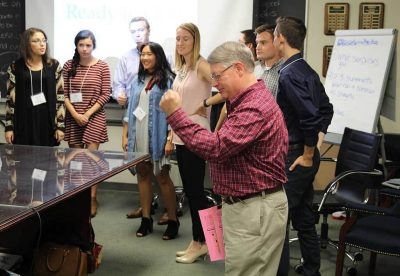 Barry O'Donnell, Assistant Professor of Practice in Management, leads the students through a team building exercise called Quest.