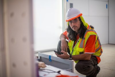Center for Power Electronics researcher Vladimir Mitrovic of Belgrade, Serbia, works on the electronics inside the house during construction.