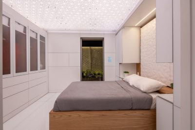 The bedroom features a Murphy bed to maximize the house's space. The smart bed itself can monitor quality of sleep and automatically adjust for the user. (Photo by Erik Thorsen)