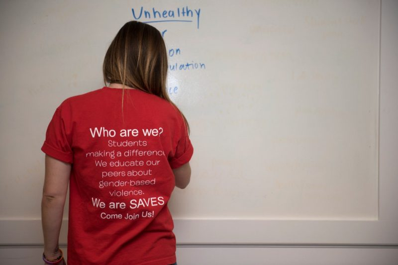 This shows a student in the SAVES program, wearing a shirt with the program's message on it.