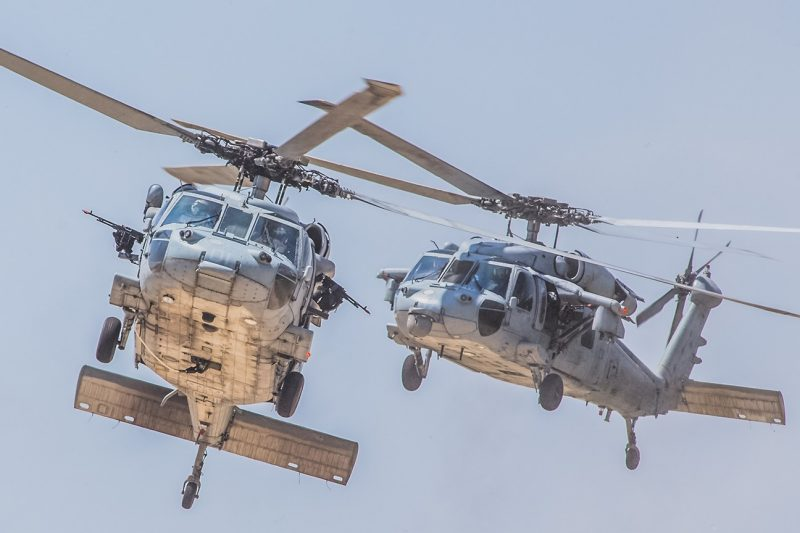 Two MH-60S Knighthawk aircraft fly.