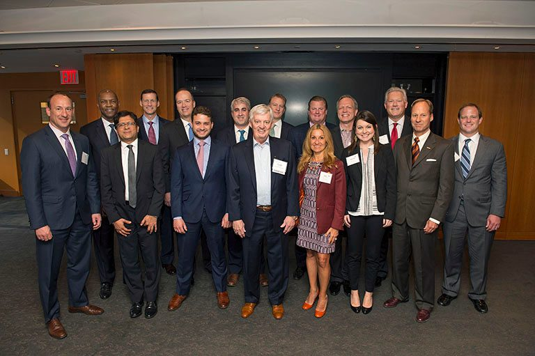 THE ADVISORY BOARD of the Department of Finance pose with retired football coach Frank Beamer in New York. FROM LEFT, FRONT ROW: Nick Cullen, Vijay Singal, Ben Marshall, Frank Beamer, Tracy Castle-Newman, Christina Todd, Mike Clarke, Kyle Korte BACK ROW: Michael Robinson, Greg Carter, David Hogan, Michael Aldrich, Steve Pierson, Braun Jones, Joe Golden (invitee), Jeff Hartman