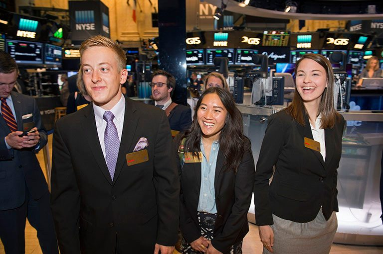 AT THE NEW YORK STOCK EXCHANGE LEFT: Kenneth Horoho, Rachel Phandinh, and Elisabeth Cox