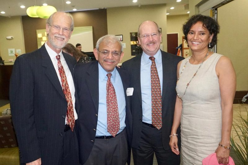 From left: Finance professors George Morgan and Raman Kumar with David Smith (Ph.D., FIN '89) and his wife Shobha Chengalur-Smith (Ph.D., STAT '89) (Photo courtesy of George Morgan and Raman Kumar)