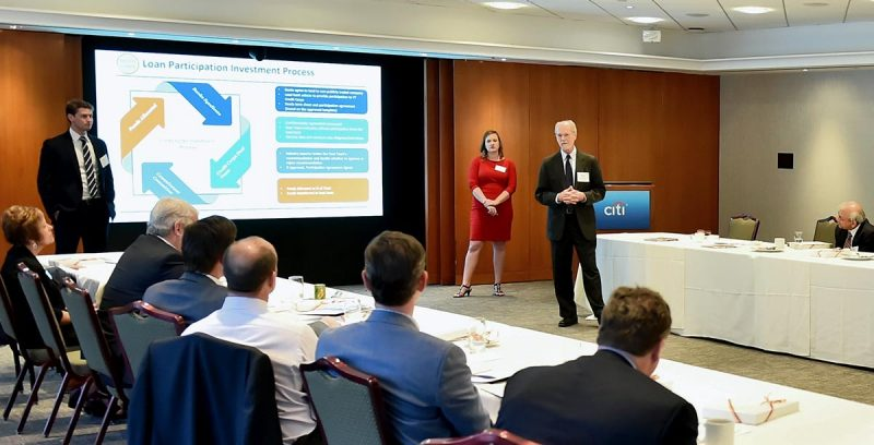 Finance professor George Morgan and finance students Quillin Gaffey (left) and Tracy Christensen present the proposal for Credit Corps at a meeting of the finance department's advisory board in New York on April 4, 2019. (Photo credit: Dana Maxson)