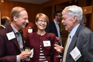 The Clarkes share a light moment with Bob Brown (right) at the 2019 Hokies on Wall Street reception. (Photo credit: Dana Maxson)