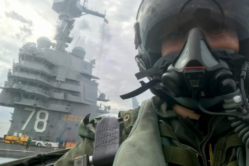 Cmdr. Stacy Uttecht waits on the deck of the USS Gerald R. Ford during a flight deck test in November 2017