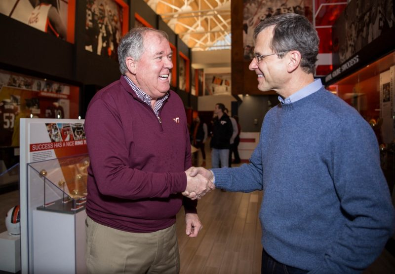 Floyd Merryman (left) with Robert Sumichrast, dean of the Pamplin College of Business. The Merryman family has committed $2 million to be split between Pamplin and the new football strength and conditioning project by Virginia Tech Athletics.