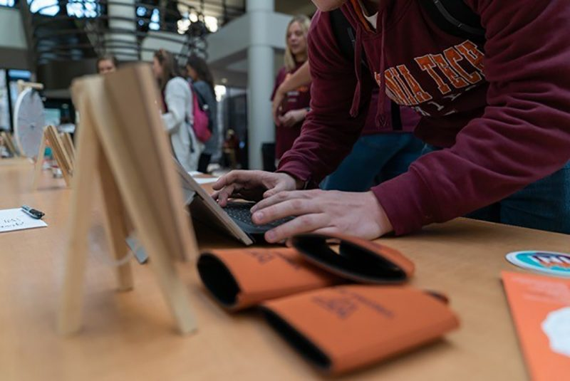 A Pamplin supporter makes an online gift in the Pamplin Hall atrium during Virginia Tech's Giving Day 2019.