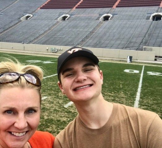 Cameron Pociask is an official Class of 2023 member, pictured here with his mom, Jen, at Lane Stadium during Hokie Focus.