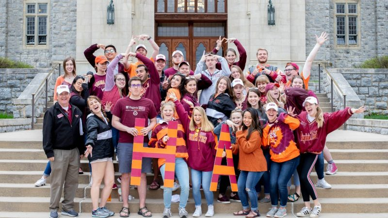 The Hokie Ambassadors get pumped up to give their signature campus tours during Hokie Focus weekend.
