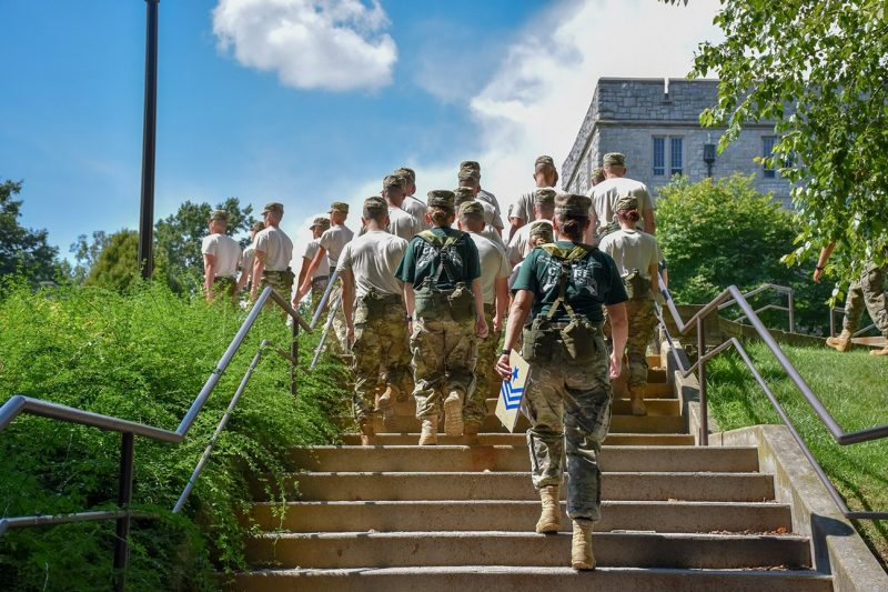Under the watchful eyes of the upper-class cadets (in green), first-year cadet practice marching in formation around campus during New Cadet Week.