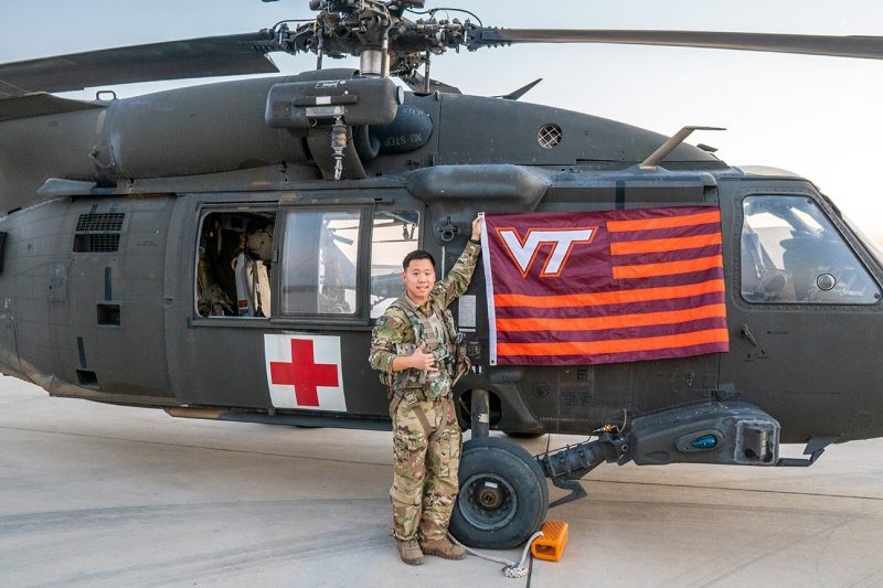 U.S. Army Capt. William Chung '15 stands with an HH-60M Blackhawk.