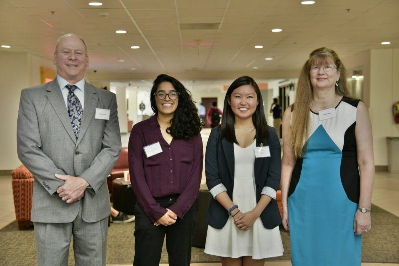 Computer science alumni Dean and Nora Kirstein, longtime champions and donors of the Anne and George Gorsline Endowed Scholarship in Computer Science, share a moment with seniors Ankita Khera, second from left, and Cynthia Zhang, current recipients of the scholarship.