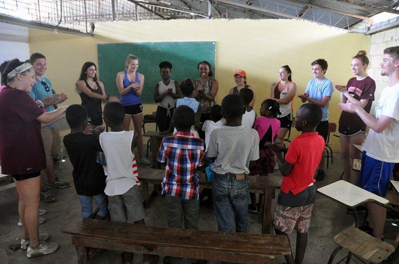 "Virginia Tech students singing ""Baby Shark"" with students of the Project Esperanza school in Puerto Plata, Dominican Republic, during their after-school English Club."