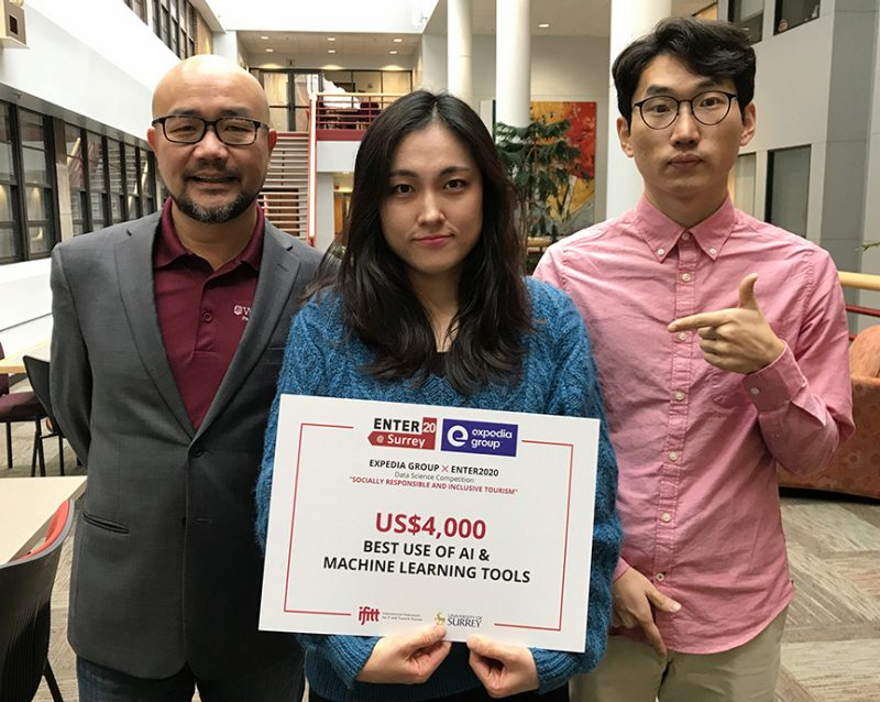 "Feiertag HTM Associate Professor Zheng ""Phil"" Xiang, Hyoeun ""Rosa"" Kim, and University of Iowa student Junho Yoon with their first place award at the Expedia Group X ENTER2020 Data Science Competition."