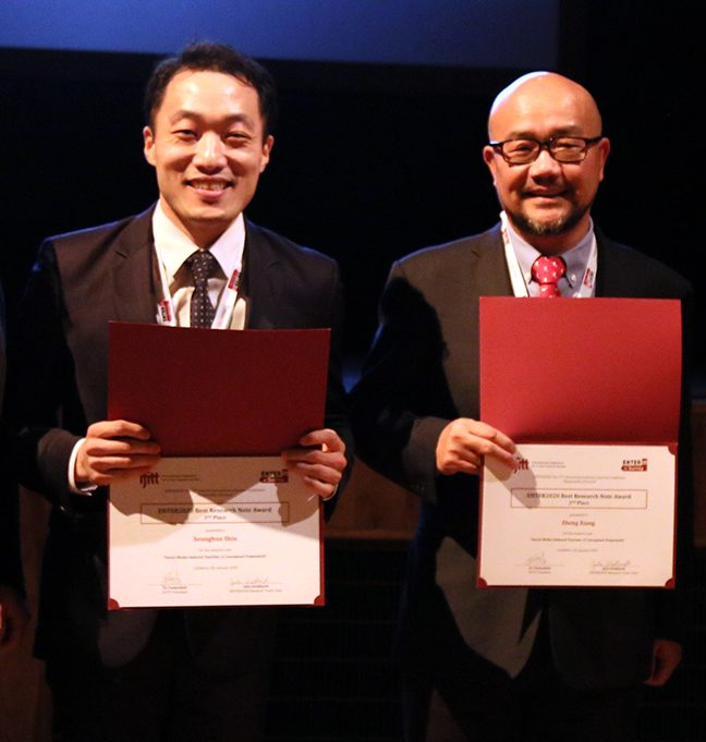 Seunghun Shin and co-author Xiang with their second place award for Best Research Note.